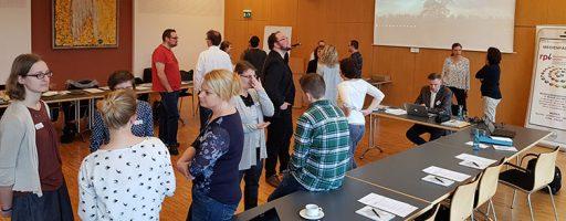 Menschen in einem Tagungsraum
