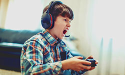 crazy-dependent-kid-shouting-while-playing-mass-multiplayer-video-game-online-at-home-1651138978-sakkmesterke-shutterstock-.jpg