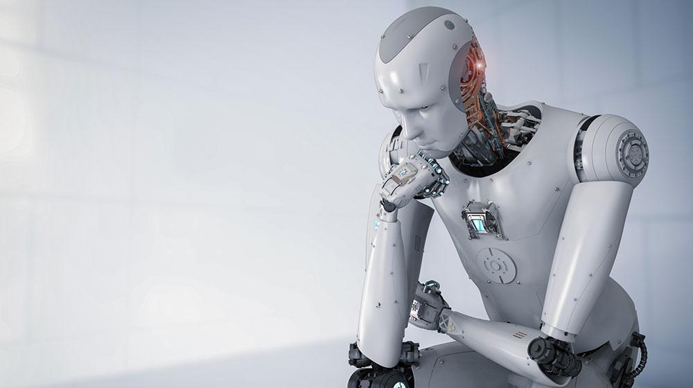 KI Digitalität soziale Frage - Roboter sitzt und denkt